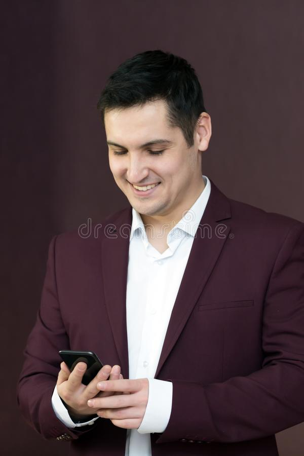 A man rejoices buying. A mobile phone stock images