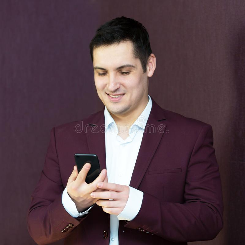 A man rejoices buying. A mobile phone royalty free stock image