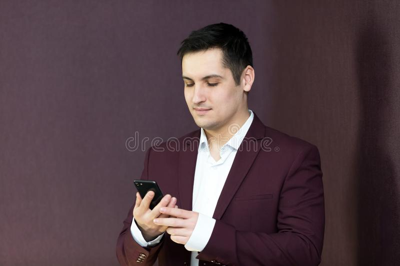 A man rejoices buying. A mobile phone stock image