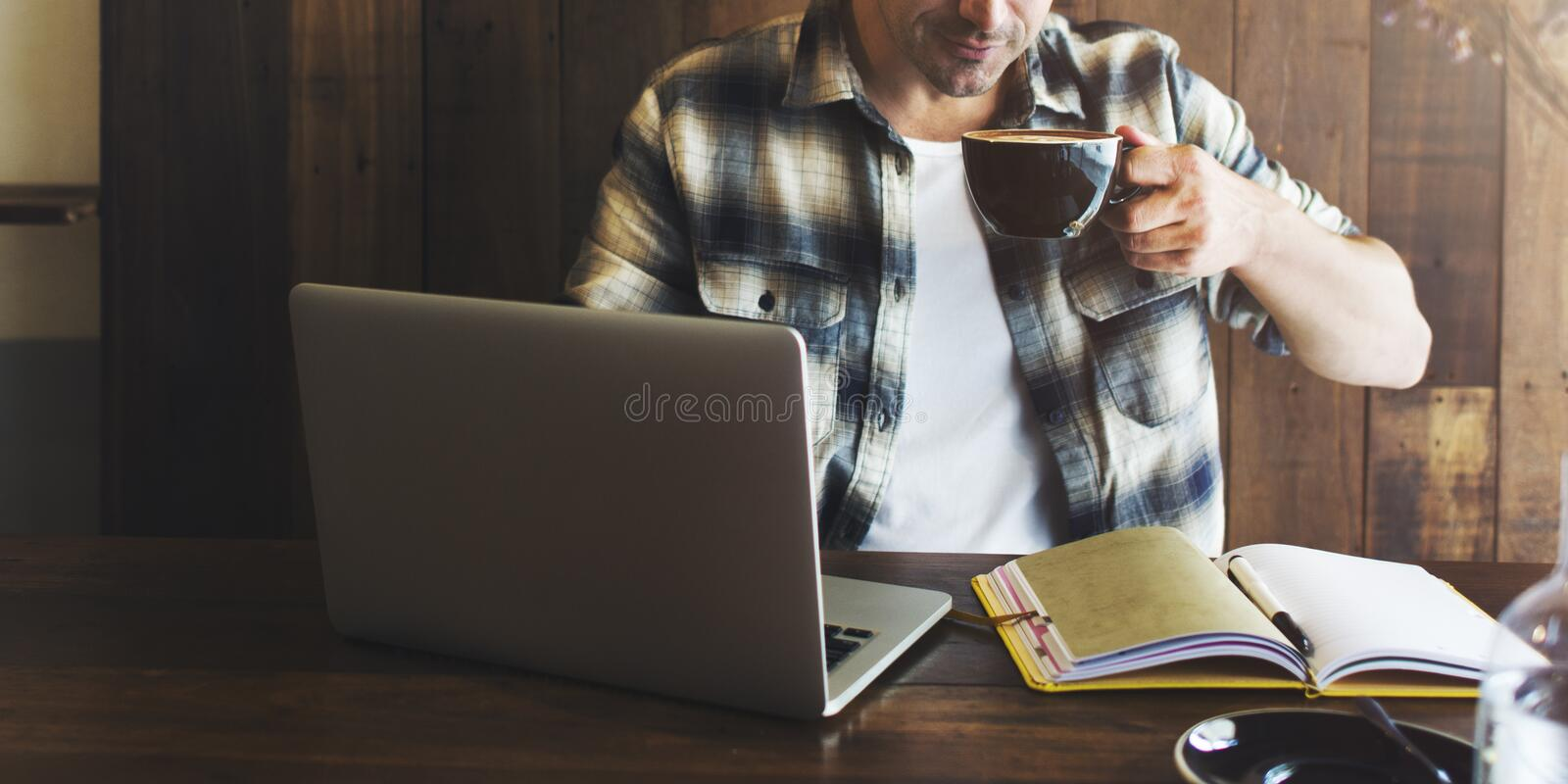 Man Relax Lifestyle Working Coffee Shop Concept.  stock photos