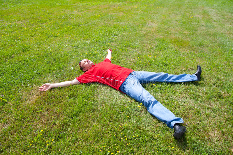 Download Man Relaxation On A Green Grass Royalty Free Stock Images - Image: 38512409