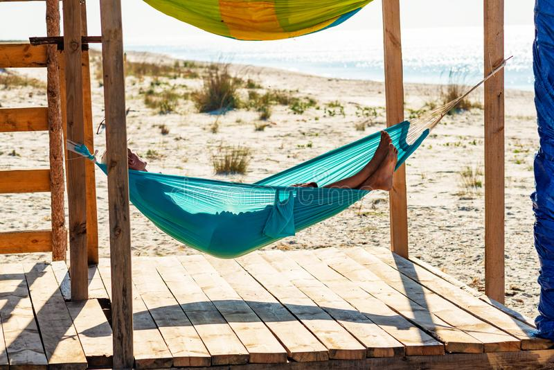 Man Relaxes In A Hammock On Abandoned Bungalow Veranda Stock Image - Image of freedom, landscape ...