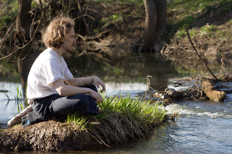 Man relaxing. Near small river