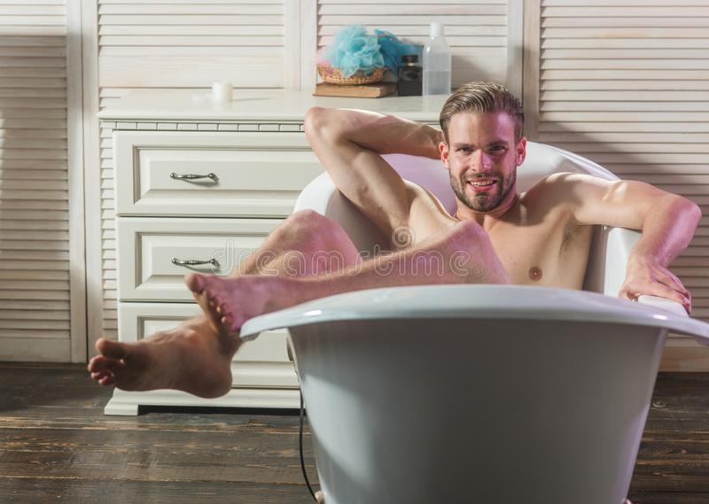 Man relaxing in bath tub royalty free stock photography