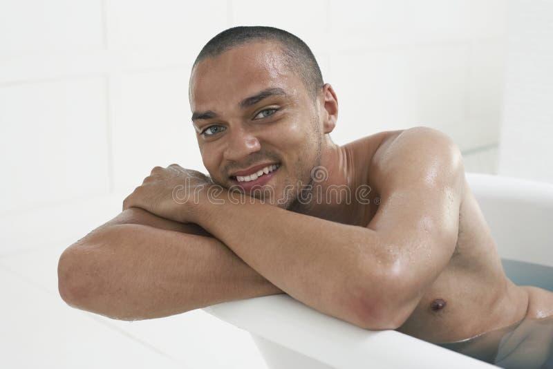 Man Relaxing In Bathtub stock photo