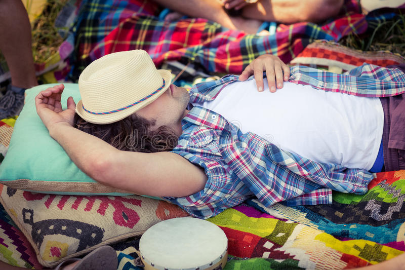 Man relaxing at campsite. On a sunny day stock photo
