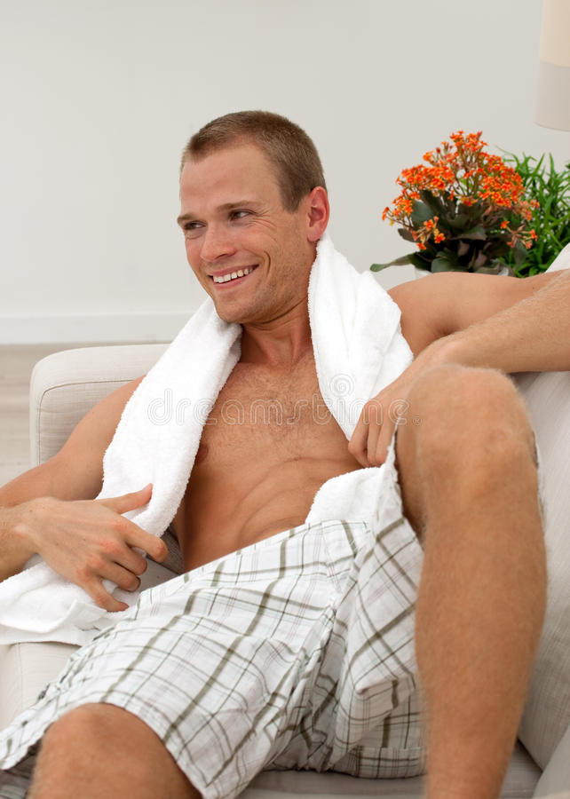 Man relaxing on the couch royalty free stock photos