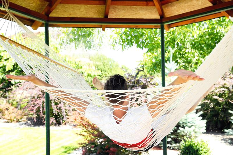 Man relaxing in hammock outdoors stock photos