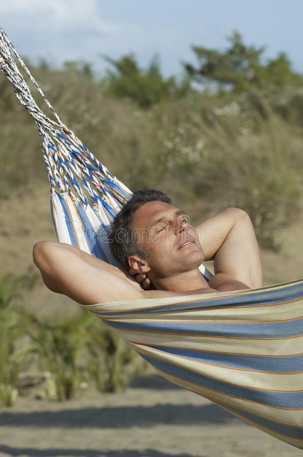 Man Relaxing In Hammock royalty free stock photography