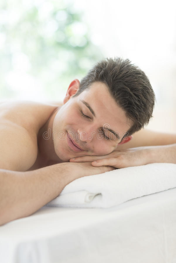 Download Man Relaxing At Health Spa stock image. Image of body - 32429811