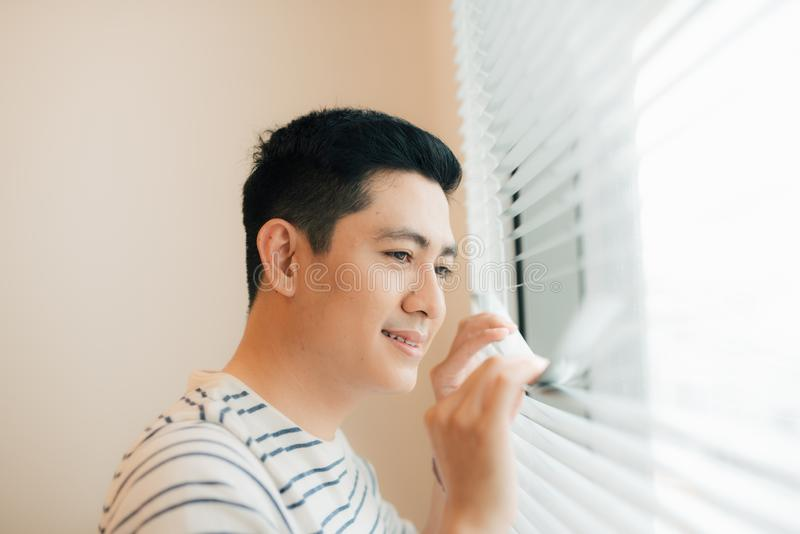 Man relaxing in his chair and enjoying the view from living room window stock photo
