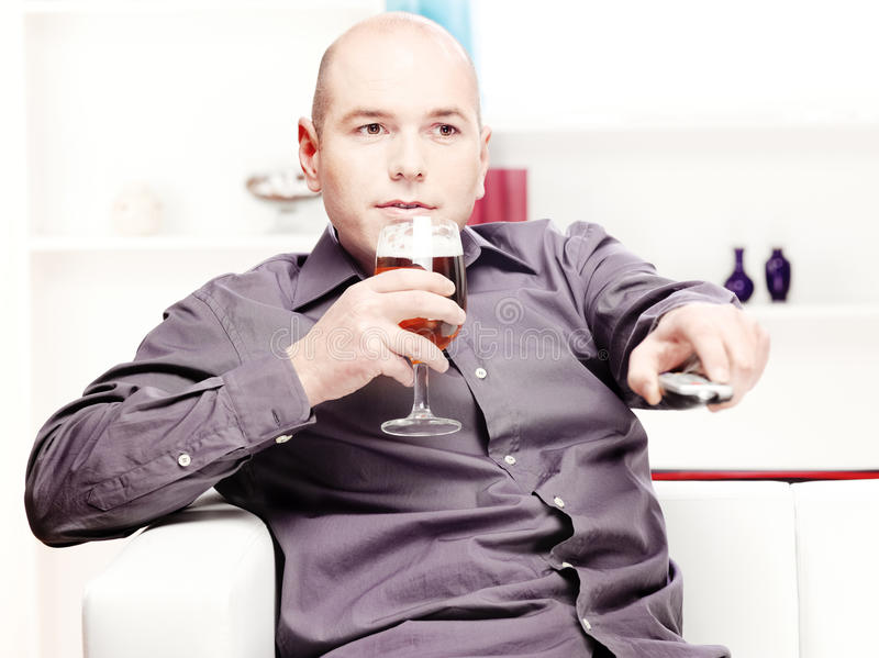 Download Man Relaxing At Home With Beer Stock Photo - Image of change, television: 23563802