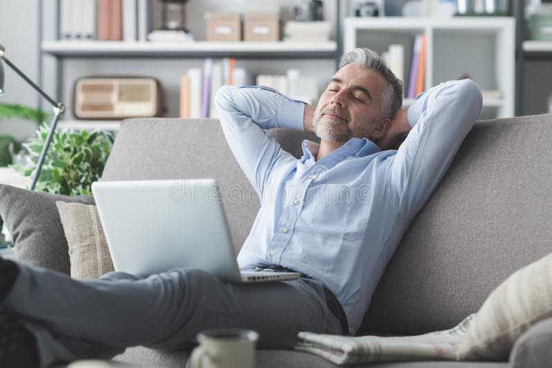 Man relaxing at home stock photo