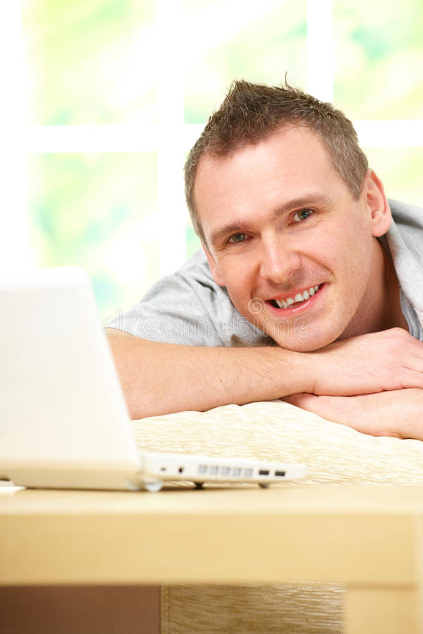 Download Man relaxing with laptop stock image. Image of home, colour - 17714251