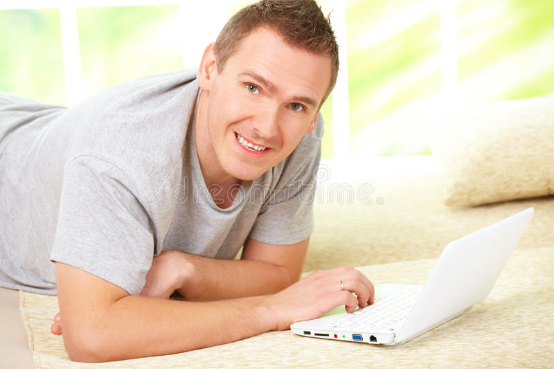 Man Relaxing With Laptop Royalty Free Stock Images