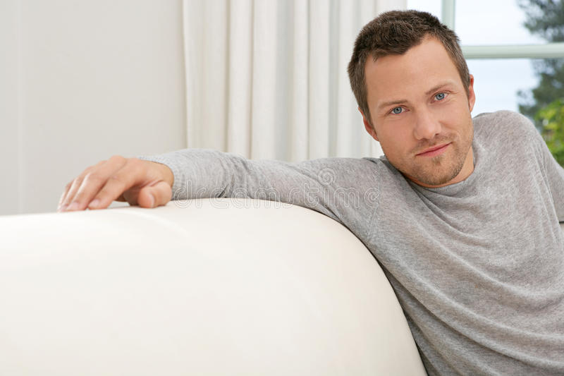 Download Man Relaxing On Sofa At Home. Stock Photo - Image: 29315610