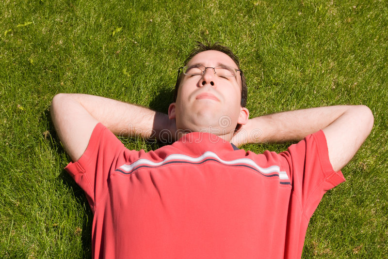Man Relaxing In The Sun Stock Photo