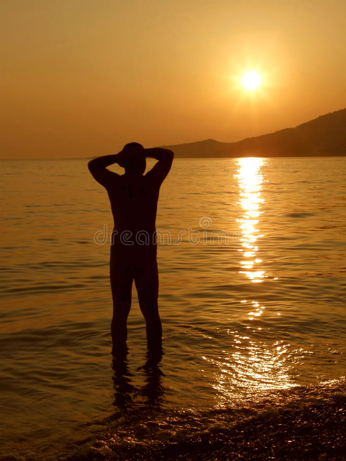 Man relaxing at sunset on sea
