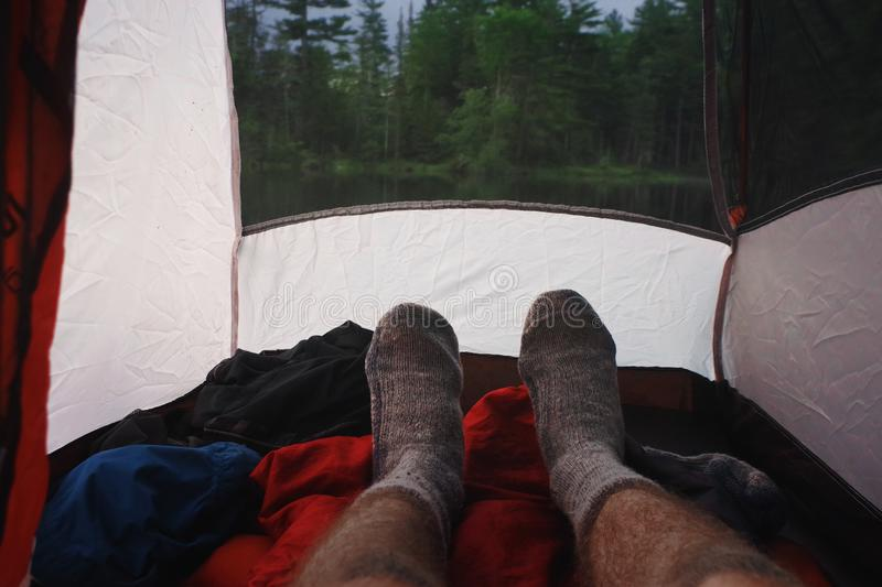 Wool socks of a man relaxing inside his tent campsite in the Adirondack Mountains. royalty free stock photos