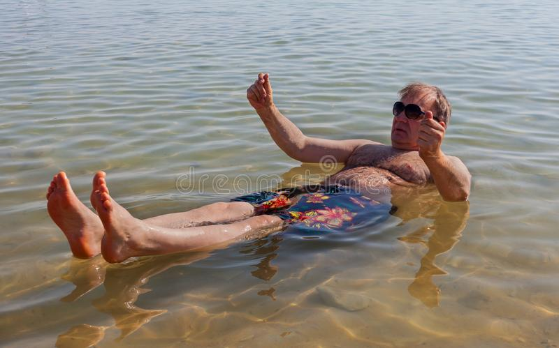 Man relaxing in water stock photography