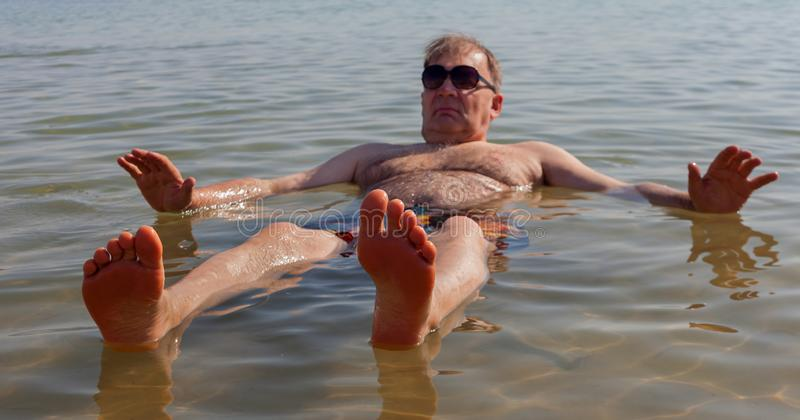 Man relaxing in water stock photos