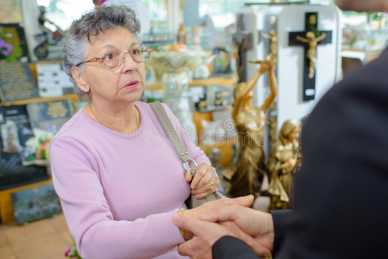 Man and religious items shop stock photo