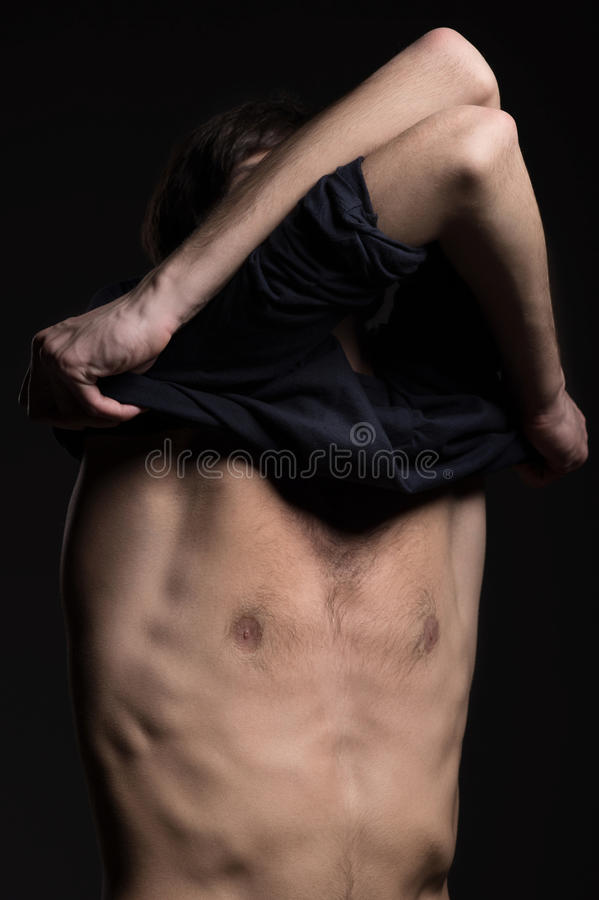 Man Remove Clothing. Stock Photos