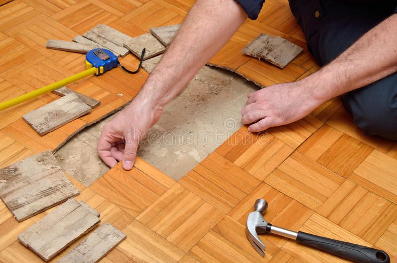Man Removing Damaged Parquet royalty free stock images