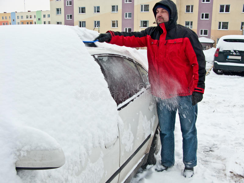 Download Man removing snow from car stock photo. Image of brushing - 12526086