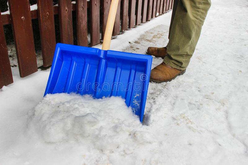 Download Man Removing Snow From The Sidewalk Stock Photo - Image: 38302796