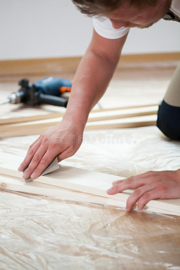 Man renovating new apartment. Vertical view of man renovating new apartment royalty free stock images