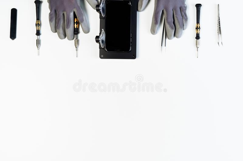 Man repair mobile phone broken display copy space stock photography