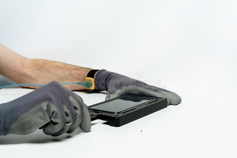 Man repair mobile phone broken display screwdriver stock photos
