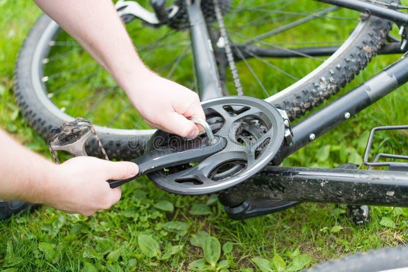 Man repairing a bicycle royalty free stock photo
