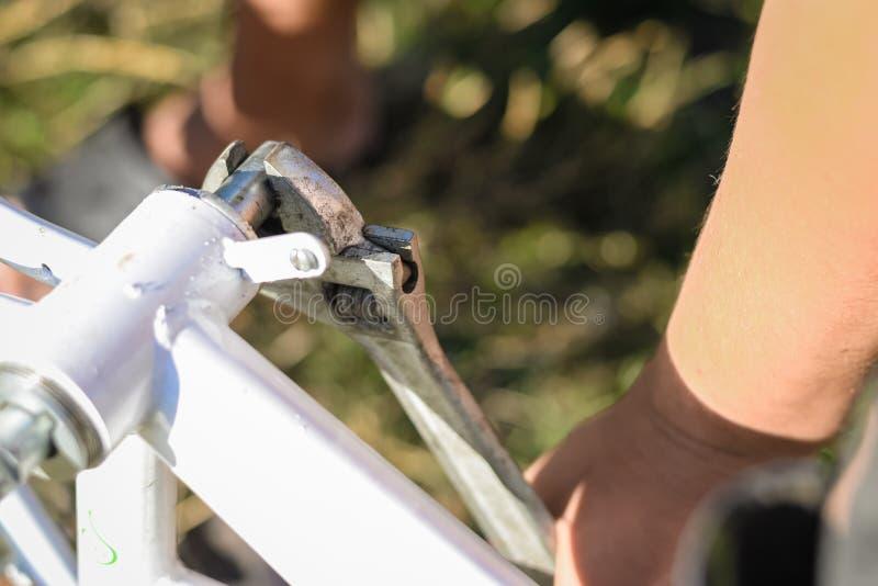 Man repairing bicycle closeup on detail stock image