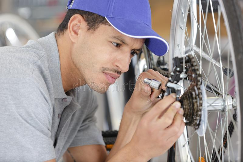 Man repairing bicycle at home royalty free stock photo