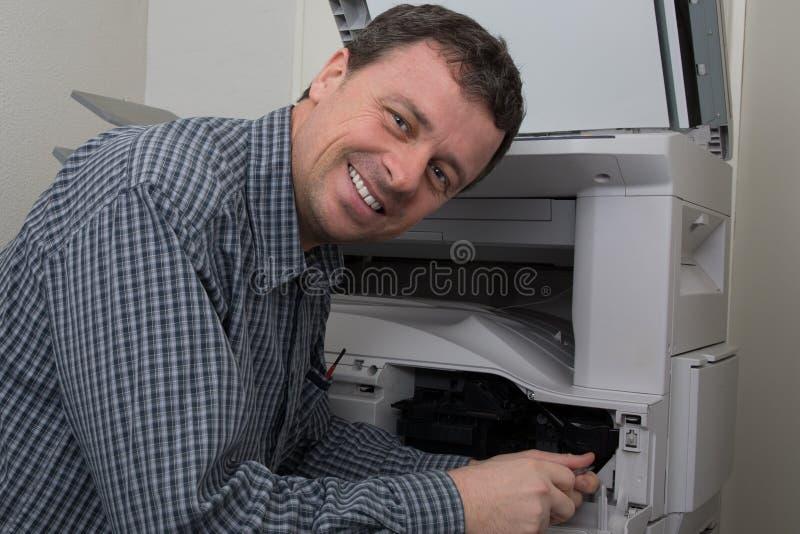 Man repairing color printer changing toner cartridge stock image