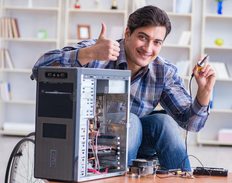 Man repairing pc with thumbs up stock photos