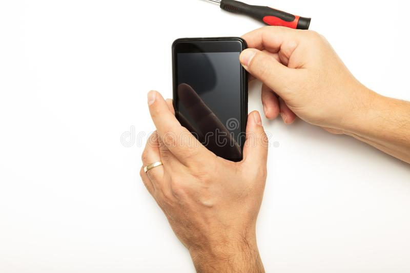 Man replacing a smartphone screen stock image