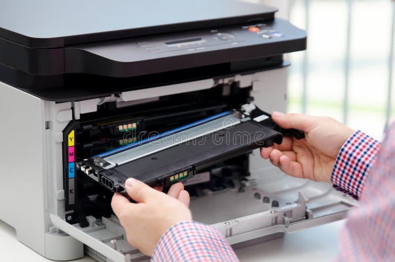 Man replacing toner in laser printer. Toner printer cartridge print laser office supplies refill concept royalty free stock photography