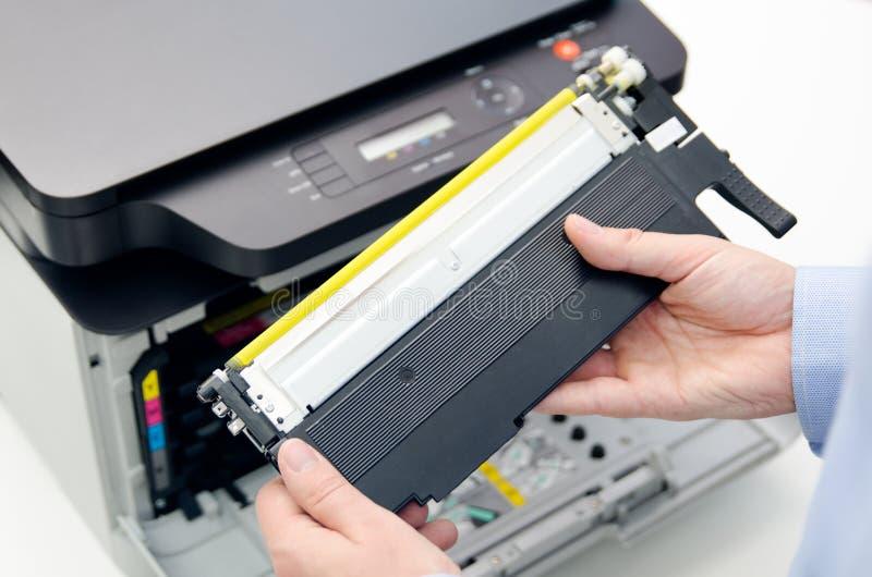 Man replacing toner in laser printer. Toner printer cartridge print laser office supplies refill concept stock photography
