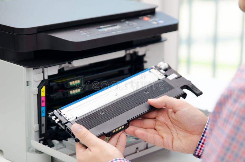 Man replacing toner in laser printer. Toner printer cartridge print laser office supplies refill concept royalty free stock photo