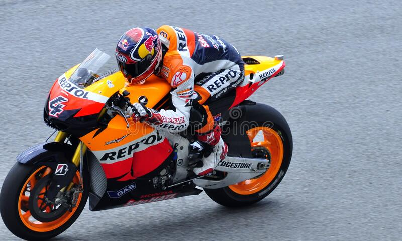 Man In Repsol Orange White And Blue Motorcycle Racing Gear Riding Sports Bike Free Public Domain Cc0 Image