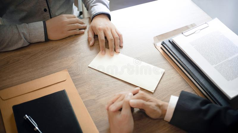 Man with resignation letter for quit a job to human resource manager.  royalty free stock images