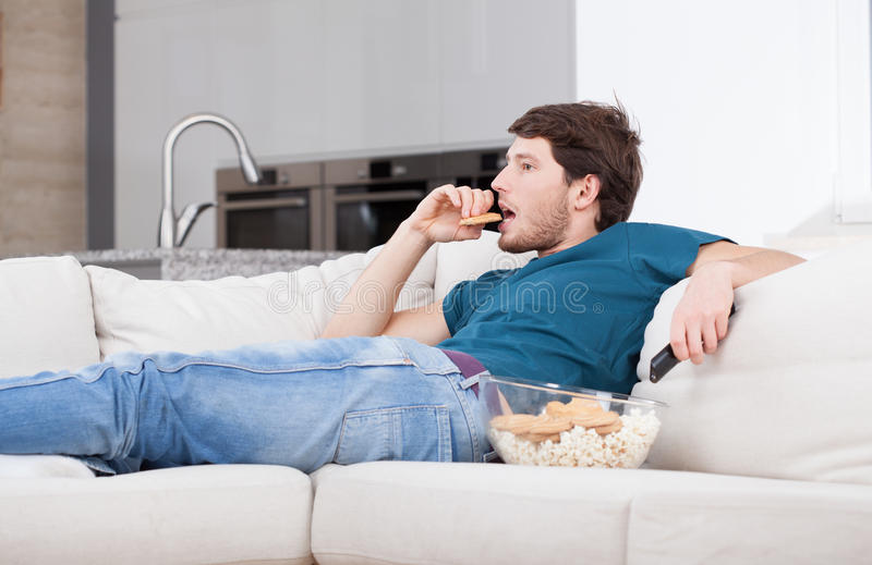 Man resting at home stock image