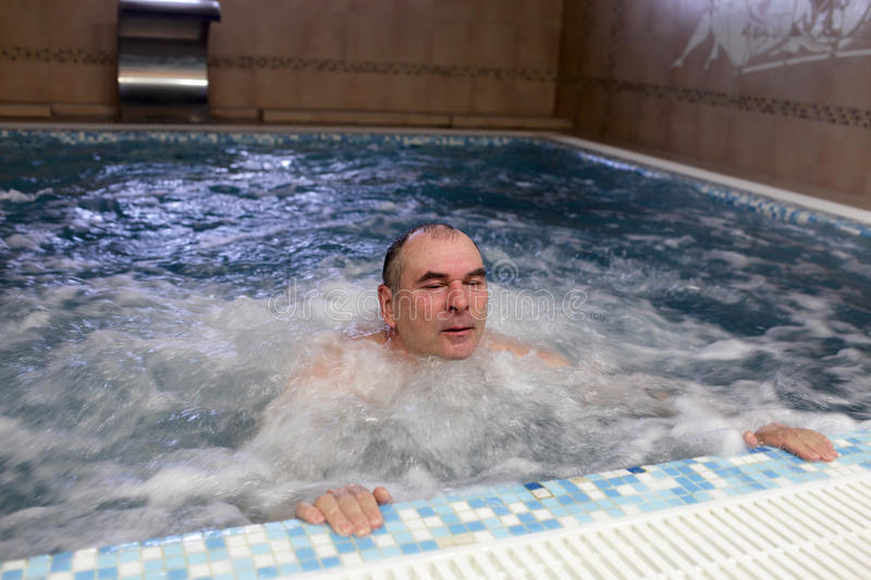 Download Man resting in jacuzzi stock photo. Image of color, adult - 25298752