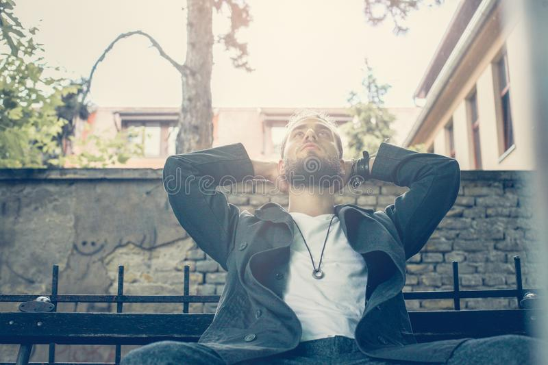 Man resting outdoor. Close up image of young men. stock photography