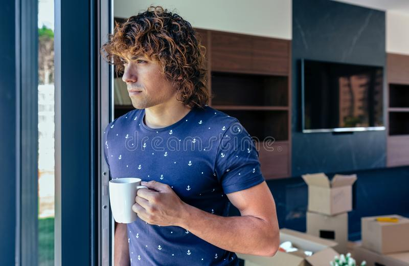 Man resting from unpacking moving boxes royalty free stock photo