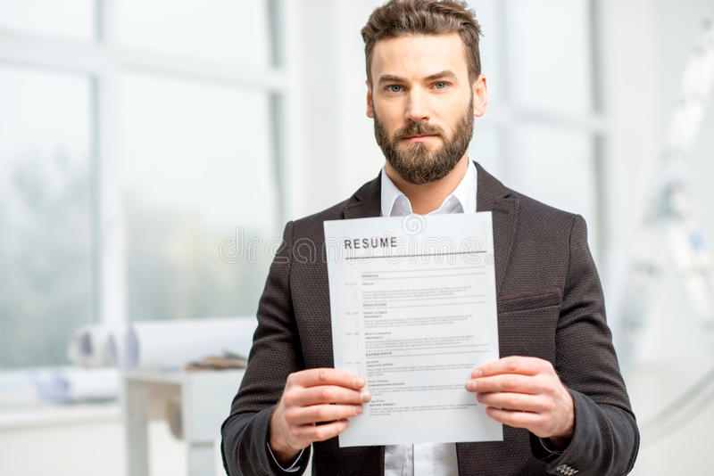 Man with resume paper royalty free stock photo
