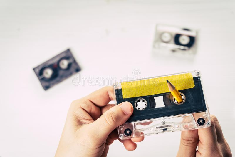 Man rewind a cassette tape stock photography